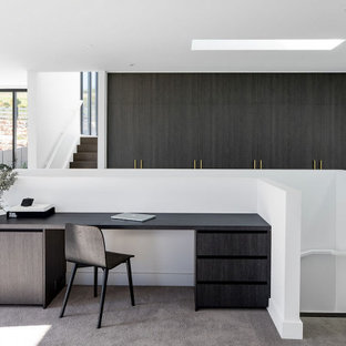 Design ideas for a small contemporary study room in Sydney with white walls, carpet and a built-in desk.