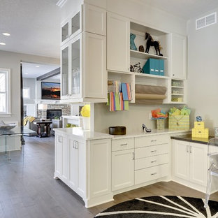 Example of a classic built-in desk craft room design in Minneapolis with gray walls and no fireplace