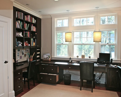 traditional home office idea in boston with a built in desk
