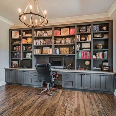 Example of a transitional built-in desk dark wood floor study room design in Charlotte with gray walls