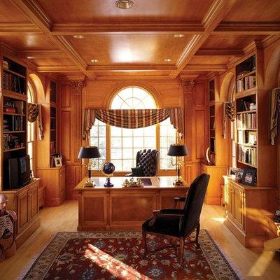 Inspiration for a timeless freestanding desk medium tone wood floor home office remodel in Boston