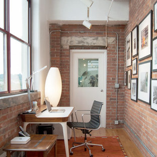 Inspiration for an industrial freestanding desk light wood floor home office remodel in Other
