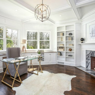 Study room - mid-sized transitional freestanding desk dark wood floor and brown floor study room idea in New York with white walls, a standard fireplace and a stone fireplace