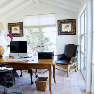 Small rural study in San Diego with beige walls, terracotta flooring and a freestanding desk.