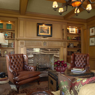 Design ideas for a medium sized traditional home office and library in Minneapolis with dark hardwood flooring, a standard fireplace and a stone fireplace surround.