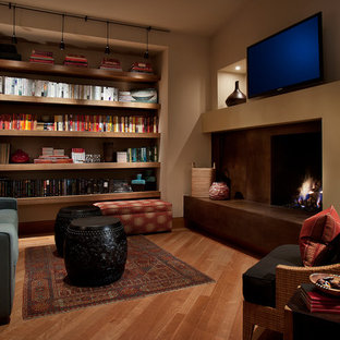 Photo of a contemporary home office and library in Phoenix with a standard fireplace and a concrete fireplace surround.