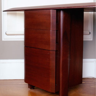 Example of a mid-sized trendy freestanding desk light wood floor study room design in San Francisco