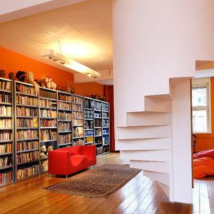 Свежая идея для дизайна: кабинет в современном стиле с оранжевыми стенами - отличное фото интерьера
