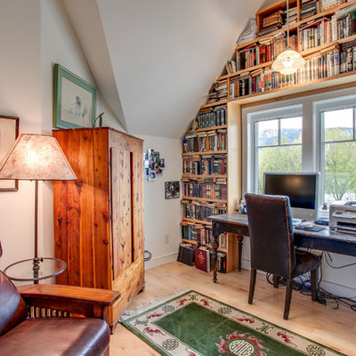 Inspiration for a farmhouse freestanding desk light wood floor study room remodel in Seattle with white walls and no fireplace