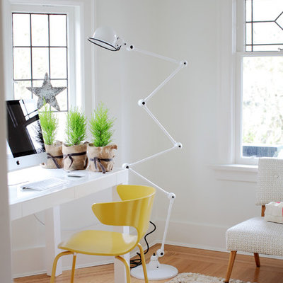 Inspiration for an eclectic freestanding desk home office remodel in Vancouver