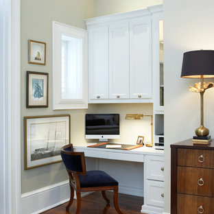 Study room - small traditional built-in desk dark wood floor study room idea in Other with beige walls and no fireplace