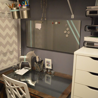 Inspiration for a small contemporary home office in Toronto with purple walls, ceramic flooring, a built-in desk and grey floors.