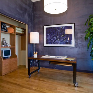 Design ideas for a world-inspired study in Los Angeles with purple walls, light hardwood flooring, no fireplace and a freestanding desk.