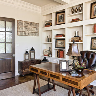Home office - traditional freestanding desk dark wood floor home office idea in Dallas with white walls