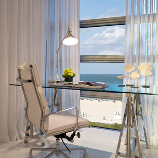 Trendy freestanding desk white floor home office photo in Miami