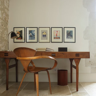 Design ideas for a midcentury study room in New York with white walls and a freestanding desk.