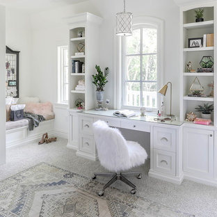 Example of a large transitional built-in desk carpeted and gray floor home office design in Chicago with white walls