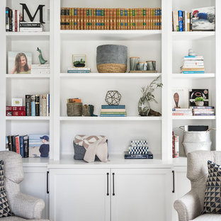 Inspiration for a large coastal medium tone wood floor and brown floor home office library remodel in Chicago with gray walls
