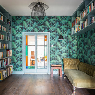 Design ideas for a medium sized eclectic home office and library in London with a reading nook, green walls, dark hardwood flooring and brown floors.