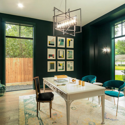 Home office library - transitional freestanding desk medium tone wood floor and brown floor home office library idea in Houston with green walls