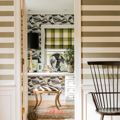 Inspiration for an eclectic built-in desk medium tone wood floor home office remodel in Boston