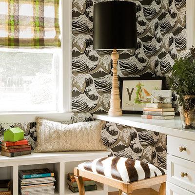 Example of an eclectic built-in desk medium tone wood floor home office design in Boston