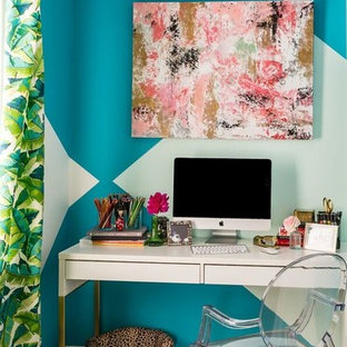 Eclectic freestanding desk medium tone wood floor home office photo in DC Metro with multicolored walls