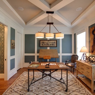 Example of an eclectic freestanding desk dark wood floor study room design in Charlotte with blue walls