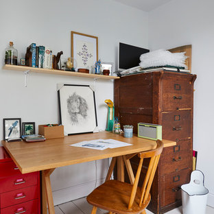 Design ideas for a bohemian study in Surrey with white walls, painted wood flooring, a freestanding desk and white floors.