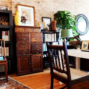Eclectic freestanding desk medium tone wood floor home office photo in Chicago