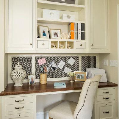 Study room - traditional built-in desk dark wood floor study room idea in Minneapolis with beige walls
