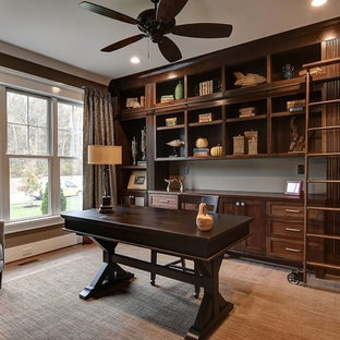 Inspiration for a mid-sized rustic freestanding desk light wood floor and beige floor study room remodel in Other with brown walls and no fireplace