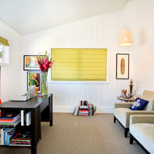 Photo of a midcentury home office in Orange County with white walls, carpet, a freestanding desk and beige floor.