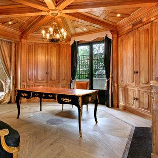 Tuscan freestanding desk light wood floor and beige floor home office photo in Orange County