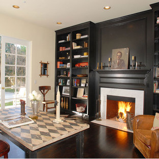 This is an example of a classic home office in Los Angeles with white walls, dark hardwood flooring, a freestanding desk and a standard fireplace.