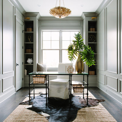 Example of a mid-sized transitional freestanding desk dark wood floor study room design in Chicago with gray walls