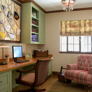 Example of a mid-sized classic built-in desk dark wood floor home office design in Boston with beige walls