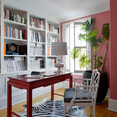 Inspiration for a large timeless freestanding desk light wood floor home office library remodel in Ottawa with pink walls and no fireplace