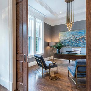 На фото: кабинет в стиле современная классика с серыми стенами, паркетным полом среднего тона, отдельно стоящим рабочим столом, многоуровневым потолком и обоями на стенах