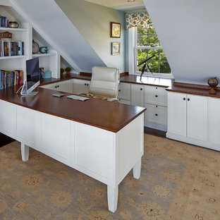 Inspiration for a mid-sized timeless built-in desk dark wood floor study room remodel in Boston with blue walls and no fireplace