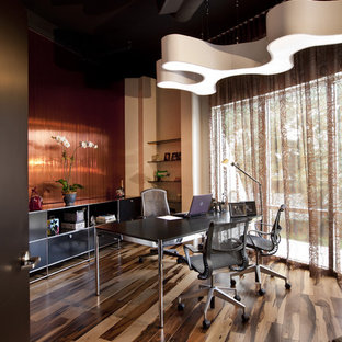 Home office - contemporary freestanding desk dark wood floor and brown floor home office idea in Orlando