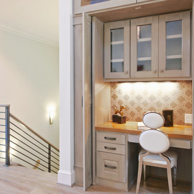 Small trendy built-in desk light wood floor and beige floor study room photo in Raleigh with beige walls and no fireplace