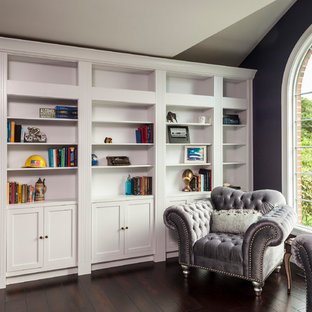 Medium sized traditional home office and library in Baltimore with a reading nook, purple walls, dark hardwood flooring, no fireplace and brown floors.