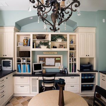 Family workshop/home office with custom built-in cabinetry, wrapping station, an