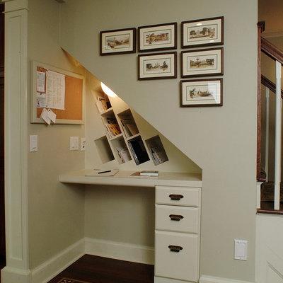 Small elegant built-in desk dark wood floor and brown floor study room photo in Other with beige walls