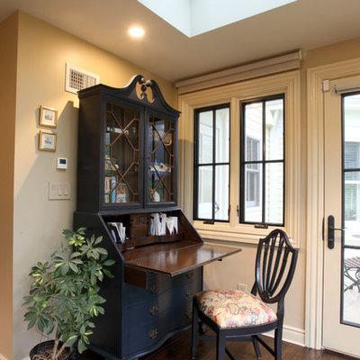 Small farmhouse freestanding desk medium tone wood floor study room photo in New York with beige walls