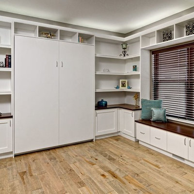 Home office - large contemporary built-in desk light wood floor and brown floor home office idea in Minneapolis with beige walls and no fireplace