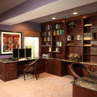 Medium sized classic home office and library in Philadelphia with purple walls, carpet, a built-in desk and white floors.
