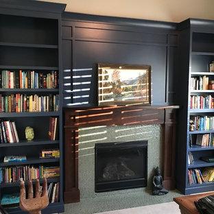 Свежая идея для дизайна: кабинет среднего размера в стиле современная классика с библиотекой, бежевыми стенами, ковровым покрытием, стандартным камином, фасадом камина из плитки, отдельно стоящим рабочим столом и бежевым полом - отличное фото интерьера
