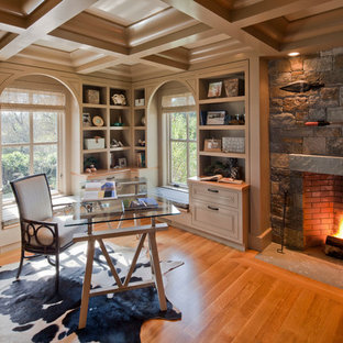 Elegant freestanding desk home office photo in Boston with a standard fireplace and a stone fireplace